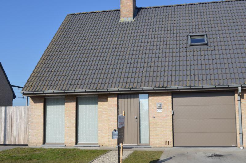 Wevelgem: Moderne instapklare halfopen woning met tuin en garage